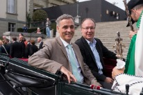^'Guest of honour day ' 14.09.2013: Guy Morin, President of the Basel Government, and Pierre-Yves Maillard, Council head of the Vaud cantonal government, taking a ride in a carriage.